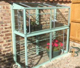 Fixing a Mini greenhouse to an uneven wall