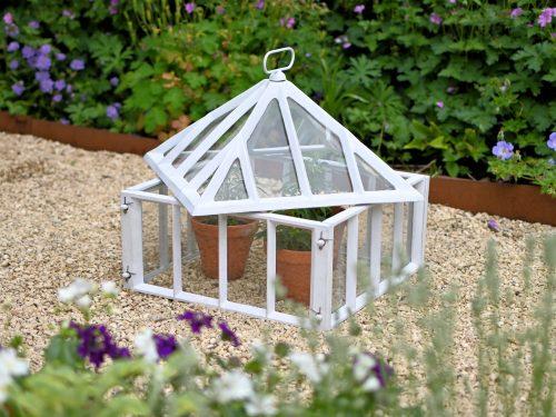 Victorian style cast iron cloche in garden
